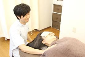 首の痛み・寝違えの施術
